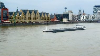 Cologne - circa may 2013 - barge passing the new waterfront of Cologne. — Stock Video
