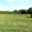 Stock Video: Tractor mowing lawn