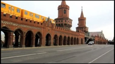 Oberbaumbridge across the spree river in Berlin, built in 1894, city train passing by. — Video Stock