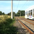 Stock Video: Fast passing tram in Cologne suburb