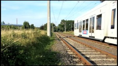 Fast passing tram in Cologne suburb — Stock Video