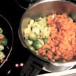 Stock Video: Brussels sprouts, carrots and potatoes for stew