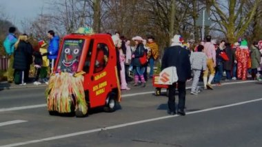 Cologne, Germany - March 2014 : Fun vehicle driving at yearly street carnival parade. — Stock Video