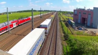 Commuter - High speed - and freight train passing by — Stock Video