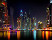 Dubai night skyscraper — Stock Photo