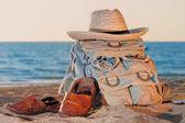 Knapsack and sandal — Stock Photo