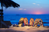 Sandals on the beach — Stock Photo