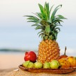 Fruit on the beach — Stock Photo