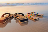 Sandals on the sand — Foto Stock