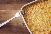 Oven homemade shepherds pie with cheesy mashed potatoes in small casserole dishes — Stock Photo