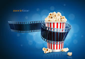 Camera film strip and popcorn. — Stock Vector
