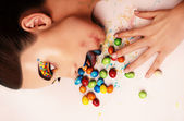 The girl with candies — Stock Photo
