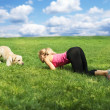 Woman playing with a dog at the park — Stock Photo