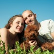 Stock Photo: Portrait of happy couple with dog lying on the grass