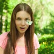 Surprised female at the park looking at the butterfly — Stock Photo