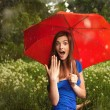 Girl with red umbrella under summer rain — Stock Photo