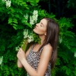 Young woman in blooming garden — Stock Photo #25400015