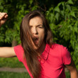 Angry girl shouting and holding her fist, want to attack — Stock Photo