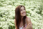 Portrait of beautiful smiling female model at the field of white — Stock Photo