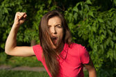Angry girl shouting and holding her fist, want to attack — Foto de Stock