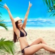 Sexy happy woman relaxing on caribbean sea, hands to the air — Stock Photo