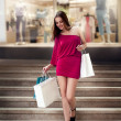 Shopping young woman in shopping mall — ストック写真