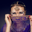 Portrait of an oriental woman in a traditional costume half of f — Stock Photo