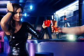 Woman drink at night club bar — Stock Photo