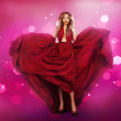 Woman in red dress shaped as heart — Stock Photo #48453329