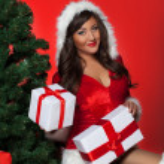 Female santa near Christmas tree with  gifts — Stock Photo #48455263