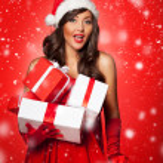 Santa girl holding Christmas gifts — Stock Photo #48455301