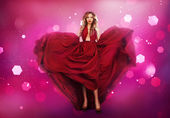 Woman in red dress shaped as heart — Stock Photo