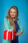 Smiling woman hold  red gift box — Stock Photo