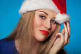 Young woman wearing Santa hat — Stock Photo