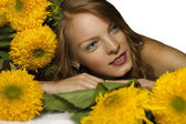 Red-haired woman with yellow flowers — Stock Photo