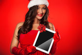 Christmas girl  hold tablet pad computer present — Stock Photo
