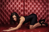 Sexy woman  lying on  leather sofa wall, — Стоковое фото