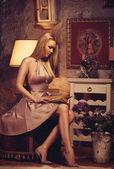 Sensual lady reading book — Stock Photo