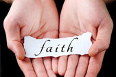 Man holding faith word — Stock Photo
