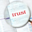 Magnifying trust word — Stock Photo