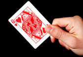 Holding Red Queen card — ストック写真