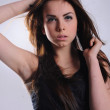 Brunette girl in a black T-shirt — Stock Photo