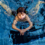 Swimming boy — Stock Photo