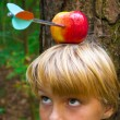Boy with apple on his head — Stock Photo