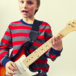 Stock Photo: Rocking boy