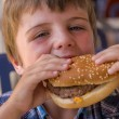 Boy with hamburger — Stock Photo