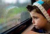 Boy staring through window — Stock Photo