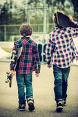 Walking skater boys — Stock Photo