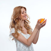 Beautiful young smiling woman with fruits — Stock Photo
