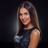 Portrait of a beautiful smiling woman with red lips — Stock Photo